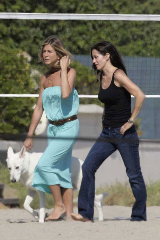 Jennifer Aniston walking her white German shepherd Polly along the beach in Malibu.