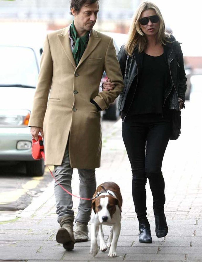 Kate Moss & Jamie Hince walking Archie, their Staffordshire cross.