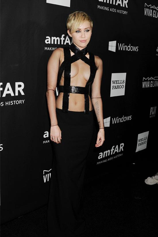 Miley Cyrus at the amfAR LA Inspiration Gala honouring Tom Ford, October 2014.