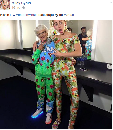 Miley and everybody spiritual godmother, Instagram star Baddie Winkle backstage at the VMA's. Image via @mtv on Instagram.