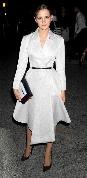 <p><strong>SEPTEMBER 20, 2014</strong></p> <p>In a Dior coat and dress after her 'HeForShe' speech at the United Nations in New York.</p>