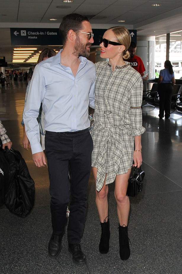 Here is Kate Bosworth looking head over heels in love with her husband, and also wearing the tie-front dress that you're seeing on the street style set everywhere. With good reason, it's cool but casual - perfect for summer. Bosworth's dress is by Ulla Johnson.