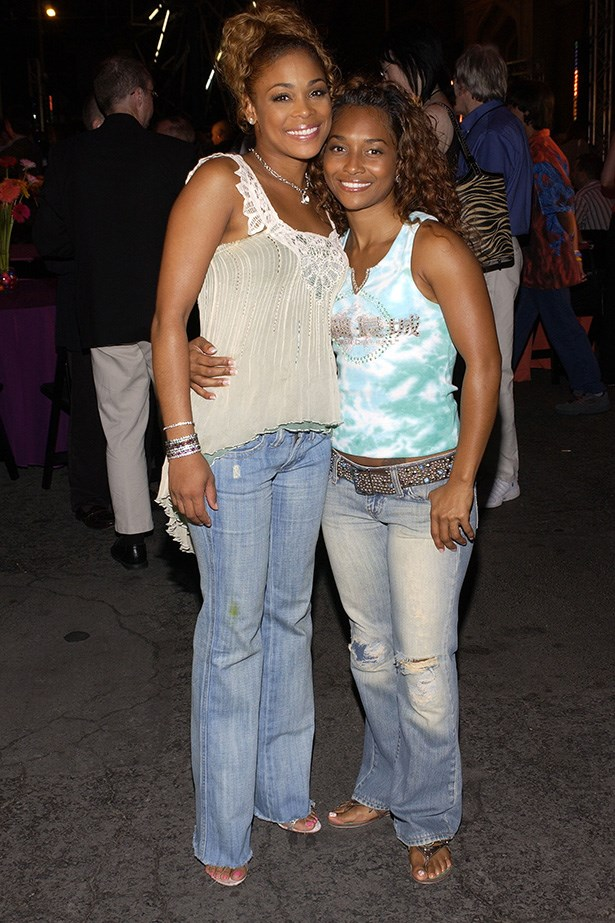 TLC defining how we all did in denim in the early 000s - super low, super boot cut and distresssssed.