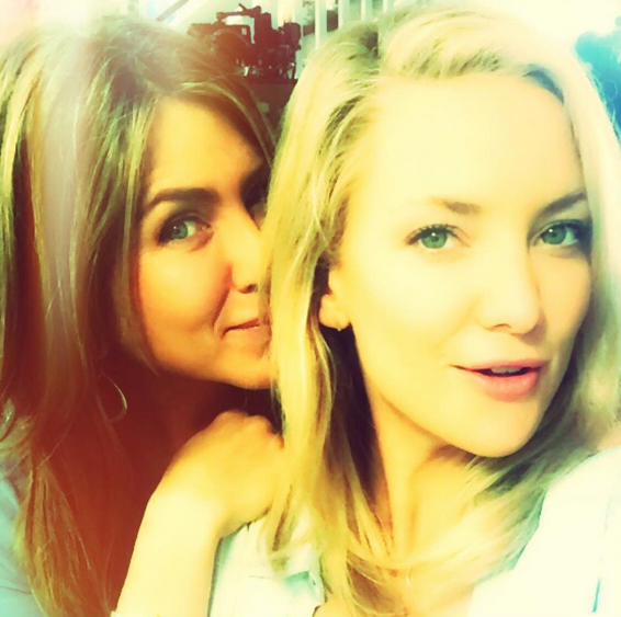 Peak selfie game from Kate Hudson who snapped her very famous and not-on-Instagram friend with the caption, Day 1: Who's that gorgeous lady peekin over my shoulder😍 #SuchFun #GirlsAtWork 👯 #MothersDayMovie #LetsConvinceJenToGetOnInstagram We can get behind this campaign fo sho.