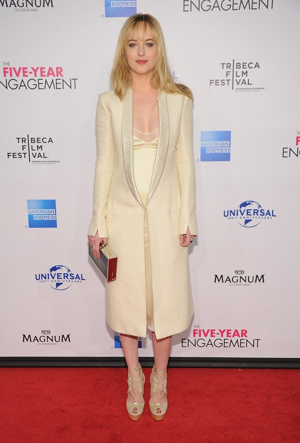 Dakota Johnson goes white-on-white at the premiere of 'The Five Year Engagement during the 2012 Tribeca Film Festival.