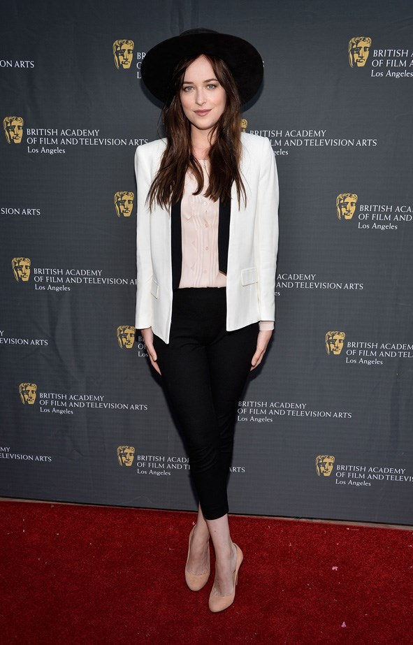 Dakota Johnson wearing the wide-brim hat of our dreams at the 26th Annual BAFTA LA Garden Party in 2013.