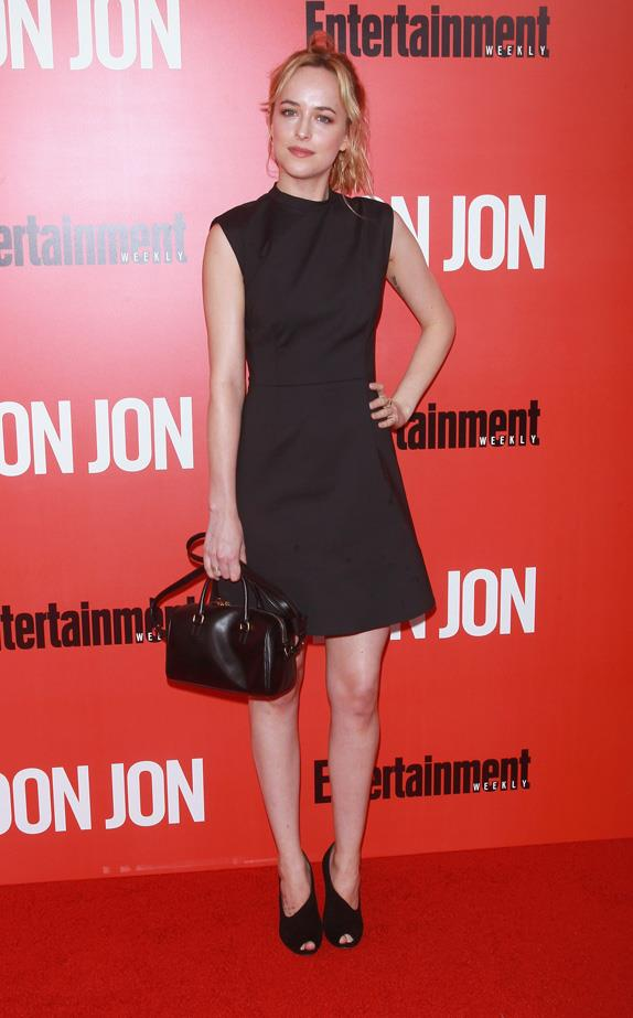 Dakota Johnson sports a LBD with a Saint Laurent bag to the 'Don Jon' New York Premiere in 2013.