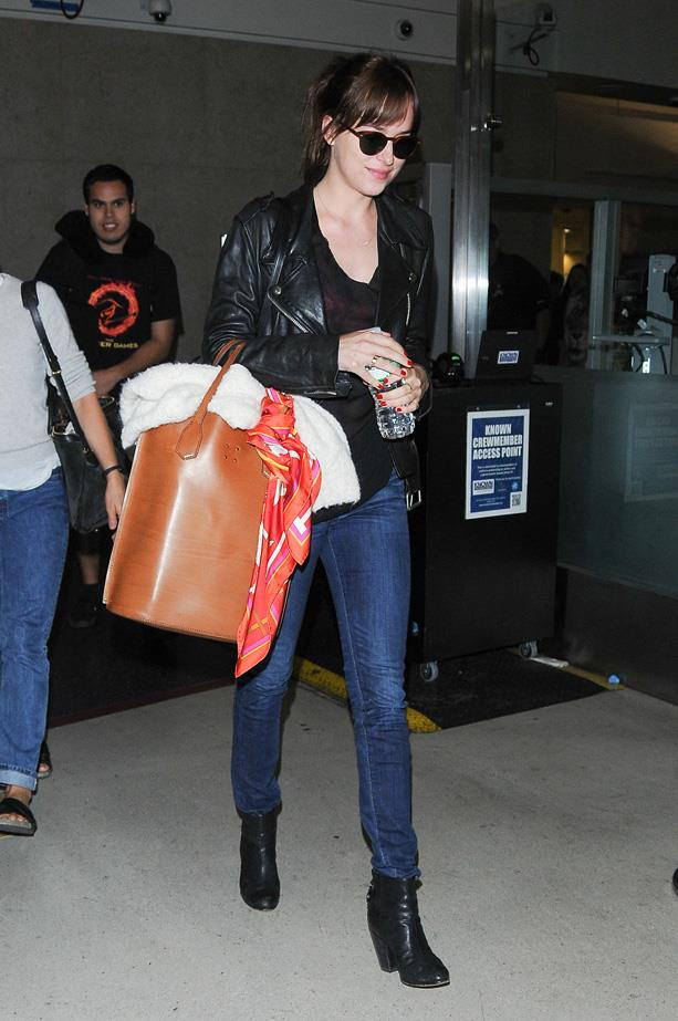 Leaving LAX in Rag & Bone boots and a leather jacket.