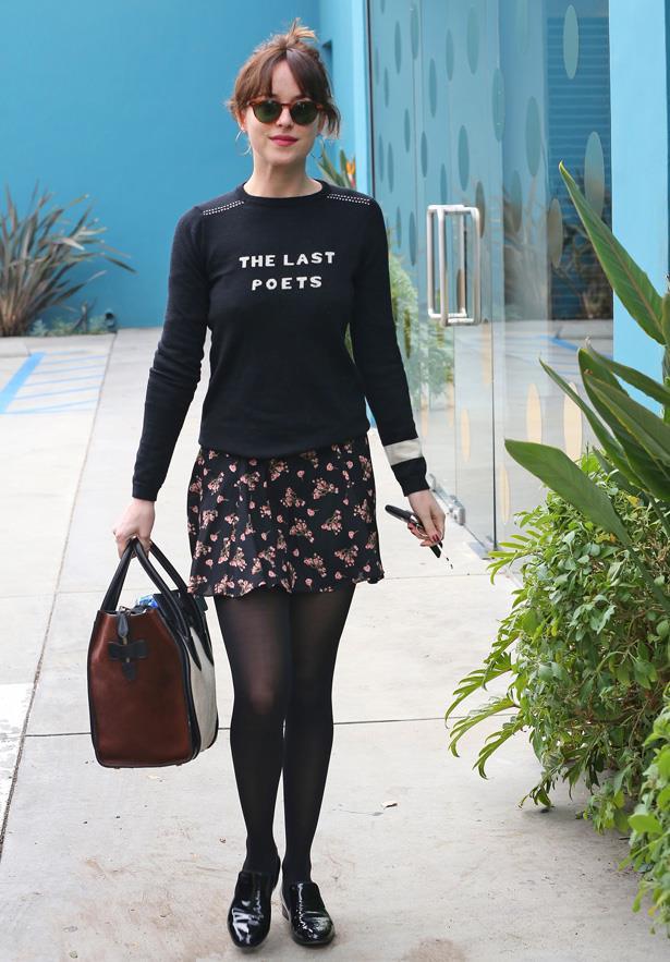 Wearing a Bella Freud jumper and Céline handbag.