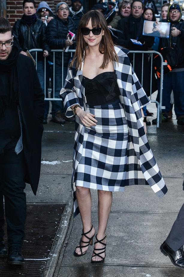 Dakota Johnson enters the 'Late Show With David Letterman' wearing some serious gingham.