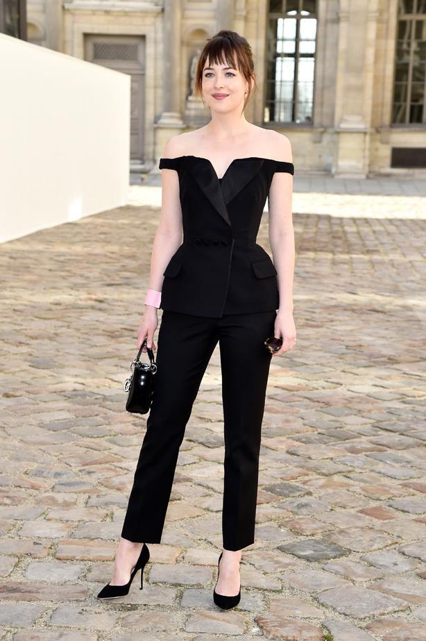 Dakota Johnson wears Dior to the Christian Dior show as part of the Paris Fashion Week Womenswear Fall/Winter 2015/2016.