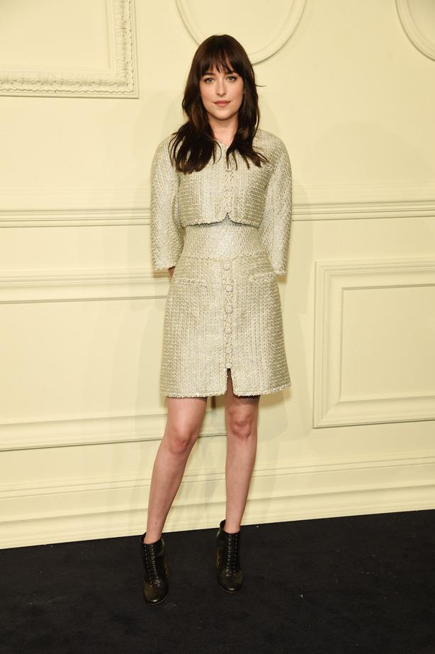 Dakota Johnson wears Chanel to the Chanel Metiers d'Art Collection 2015.