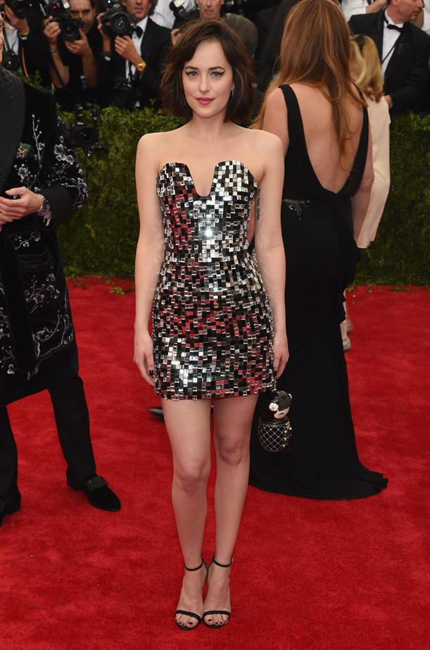 Dakota Johnson attends the 2015 Met Gala in Chanel couture.
