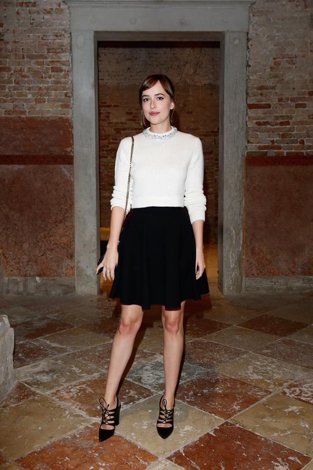 Dakota Johnson wears Miu Miu to  the Miu Miu Women's Tales Dinner during the 72nd Venice Film Festival this week.