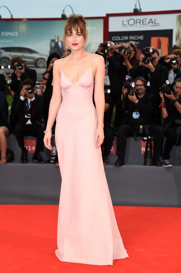 Dakota Johnson in the ultimate nude slip (by Prada) at the 72nd Venice Film Festival.