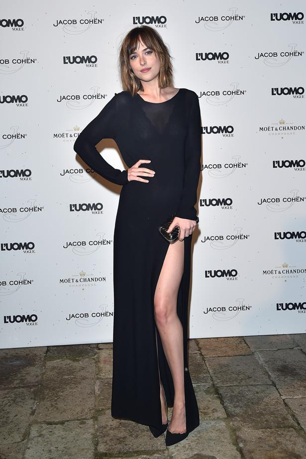Dakota Johnson shows a little leg at the 72nd Venice Film Festival.