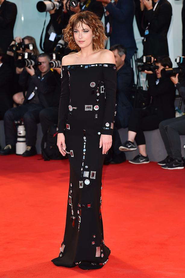 Dakota Johnson looks amazing in this unconventional dress at the premiere for 'A Bigger Splash' during the 72nd Venice Film Festival.