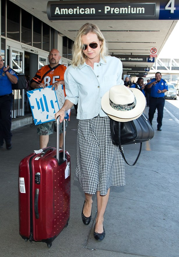 Kruger in Chanel flats and Louis Vuitton X Sofia Coppola bag.