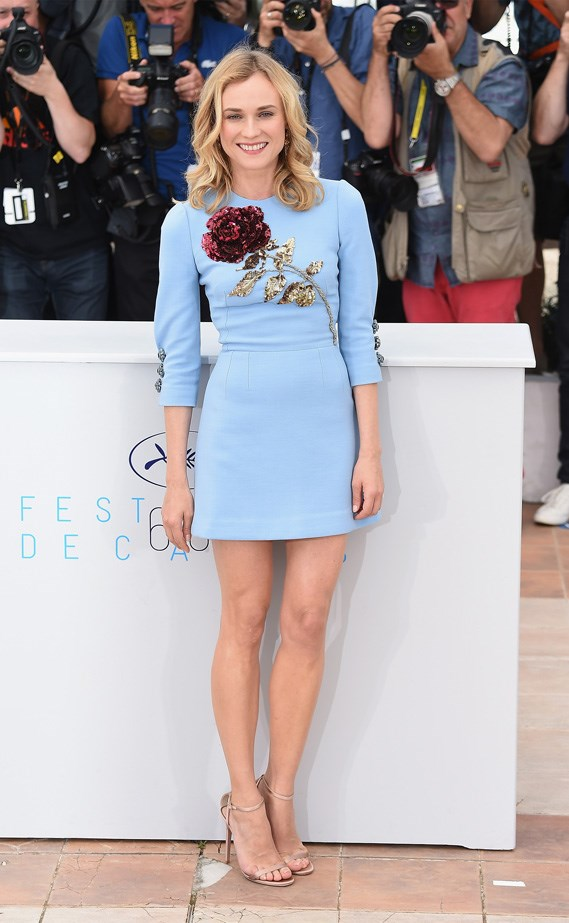 Kruger in an egg shell blue shift dress.