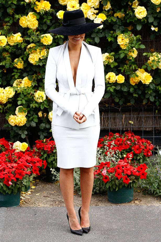 A skirt suit will always be the right choices at the races, especially when you can work it like Lara Bingle.