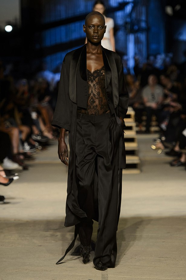 Melbourne model Ajak Deng walks with the kind of confidence required to wear Givenchy's deshabille creations. Height helps, but we figure since this look is already trailing on the floor, lack of it shouldn't be much of an issue.
