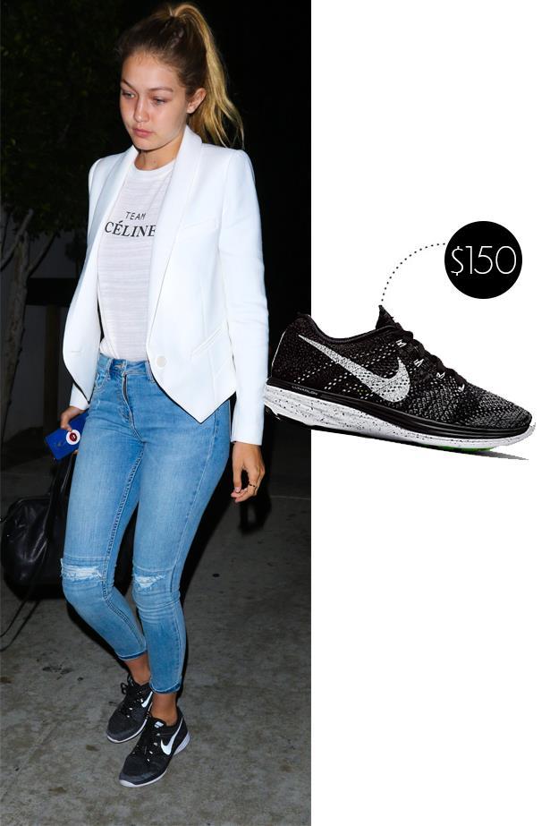 """<a href=""""http://www.farfetch.com/au/shopping/men/Nike-Flyknit-Lunar-1-sneakers-item-11042481.aspx?gclid=COGx3oqq_ccCFZclvQod38UAmQ&ef_id=VcPqWQAABQDZhDBa:20150917052433:s""""><strong>Nike Flyknit Sneakers</strong></a>, $150"""