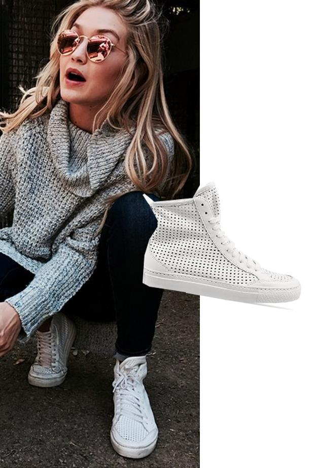 """<a href=""""https://www.shopbop.com/perforated-high-top-sneaker-mm6/vp/v=1/1577841306.htm""""><strong>Maison Martin Margiela perforated sneaker</strong></a>, $557"""
