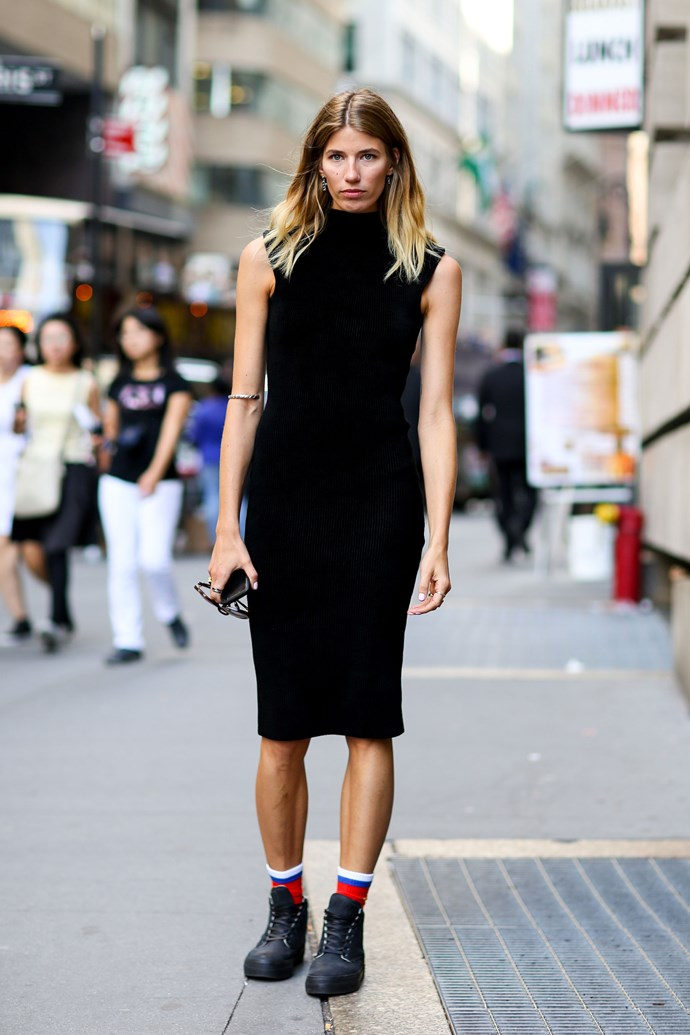 Builders boots styled with a black slip dress.