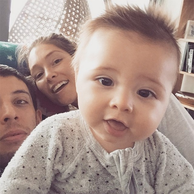 Erin McNaught and her rapper husband Example with their son Evander.