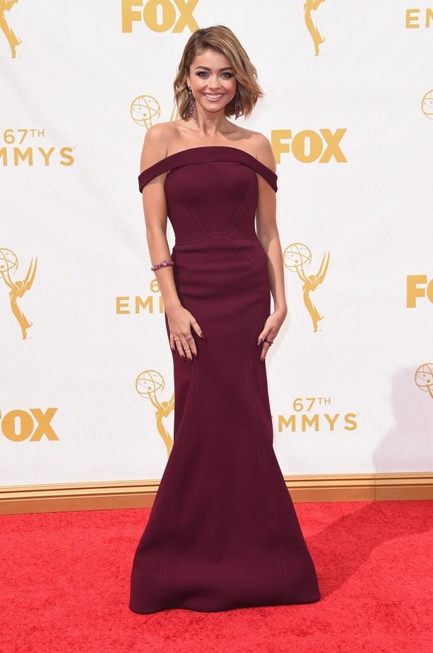 Sarah Hyland wears a burgundy Zac Posen gown.