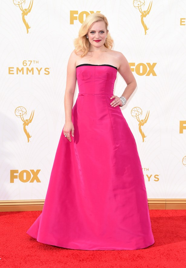 Elisabeth Moss keeps thing Mad Men inspired in this voluminous pink dress.