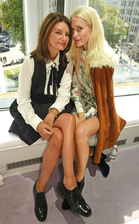 Net-a-Porter founder Natalie Massenet and it-girl Poppy Delevingne snuggle in the front row.