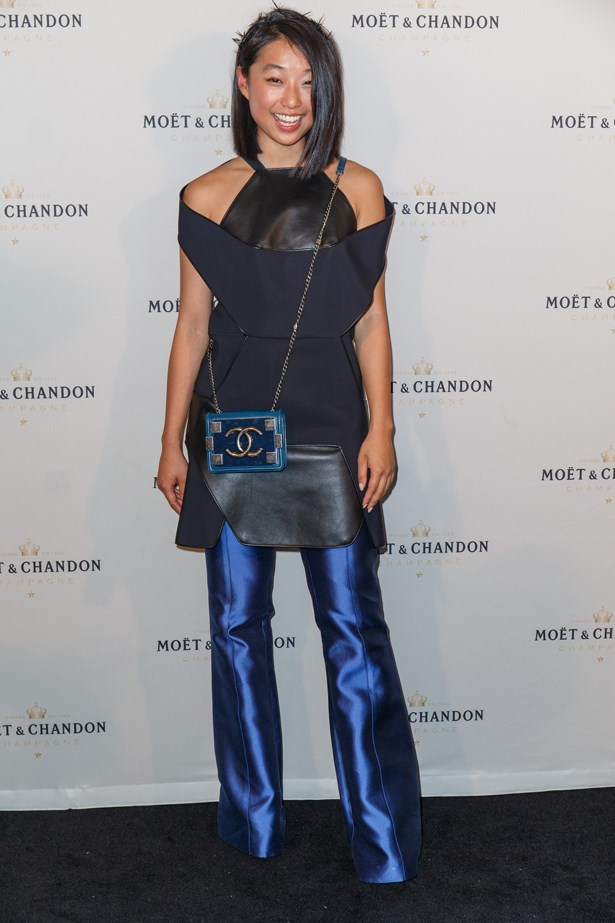 Hitting Stakes Day, Margaret Zhang of Shine By Three went with an all blue theme. Matching her electric blue trousers to a structural top, MZ finished it off with a spiked headband and a classic Chanel bag.