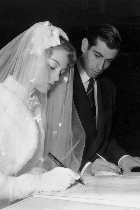 With Roger Vadim, signing the marriage register during their wedding at a church in Paris on December 20, 1952. GETTY