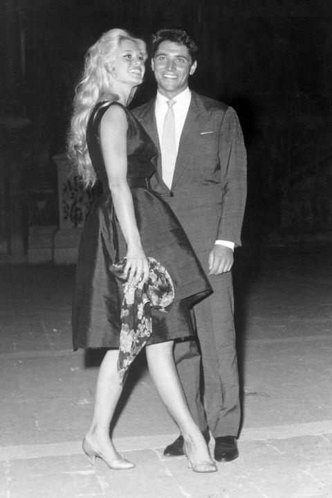 With Sacha Distel at the 19th International Film Festival of Venice on September 1, 1958. GETTY
