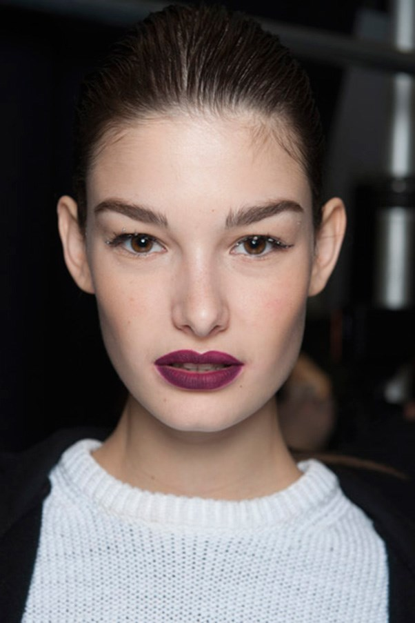 """<strong>BERRY LIPS</strong> <br><br> Statement pouts are a fashion week favourite and this season's classic crimson took a turn to the dark side. <br><br> <strong>Seen at</strong>: Carolina Herrera (pictured), Bottega Veneta, Marc Jacobs <br><br> <strong>Expert tip</strong>: """"I find that square [lip brushes] give the sharpest edge in the world. So that brush is best to create that sharp, precise line, so you can get your lipstick and fill in the middle of it and you're half way done,""""<strong> Rae Morris, Priceline Pharmacy Makeup Director. </strong>"""