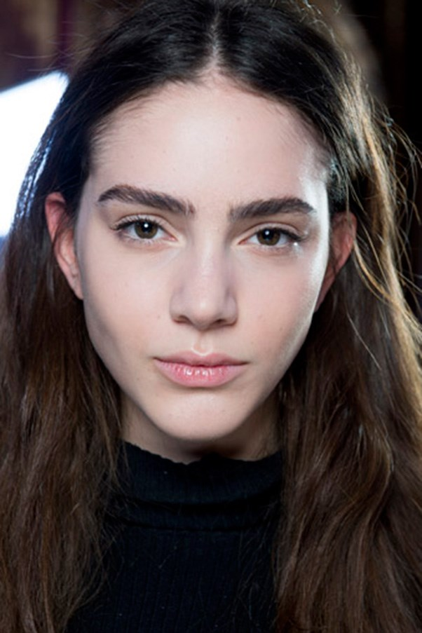 """<strong>GLOSS</strong> <br><br> Nods to the '90s have popped up backstage for a few seasons, and this time it took the form of a clear-gloss throwback, with natural, shiny lips taking centre stage. <br><br> <strong>Seen at:</strong> Roland Mouret (pictured), Giambattista Valli, Christopher Kane <br><br> <strong>Expert tip:</strong> """"I love a gloss with an SPF. In our climate, out in the sun, a super shiny product it is just like putting oil on your lips so you've got to have sunscreen,"""" says Rae Morris."""