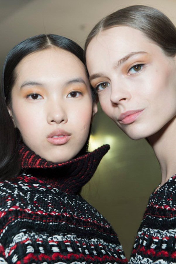 """<strong>ORANGE</strong> <br><br> Makeup artists breathed new life into a go-to autumn tone, sweeping shades of melon and burnt orange across lips and lids. <br><br> <strong>Seen at:</strong> Prabal Gurung (pictured), Preen by Thornton Bregazzi, Emilio Pucci <br><br> <strong>Expert tip:</strong> When working with dramatic colours blending is key, says Rae Morris. """"The funny thing is, the bigger the brush, the better the blend, the lighter the pressure. [You] only put product on the tip, so when you add pressure the bristles around it blend it for you, into the shape that you want,"""" she says."""