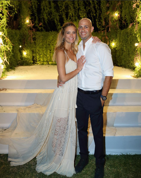 Model Bar Refaeli tied the knot with businessman Adi Ezra in Israel on September 24, and she has finally gave us a sneak peek of her wedding dress. <br><br> And, oh what a beauty it is! Simple, sheer and sexy. Refaeli captioned the pic: The happiest day of my life ! I married my best friend ✨ Live, Laugh, Love together forever More pics exclusively in @holacom magazine