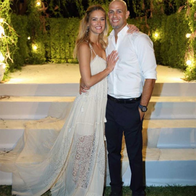 Bar Refaeli, the former Victoria's Secret model, looks beautiful in her sheer lace, laser-cut Chloé dress as she married Adi Ezra in her home country of Israel