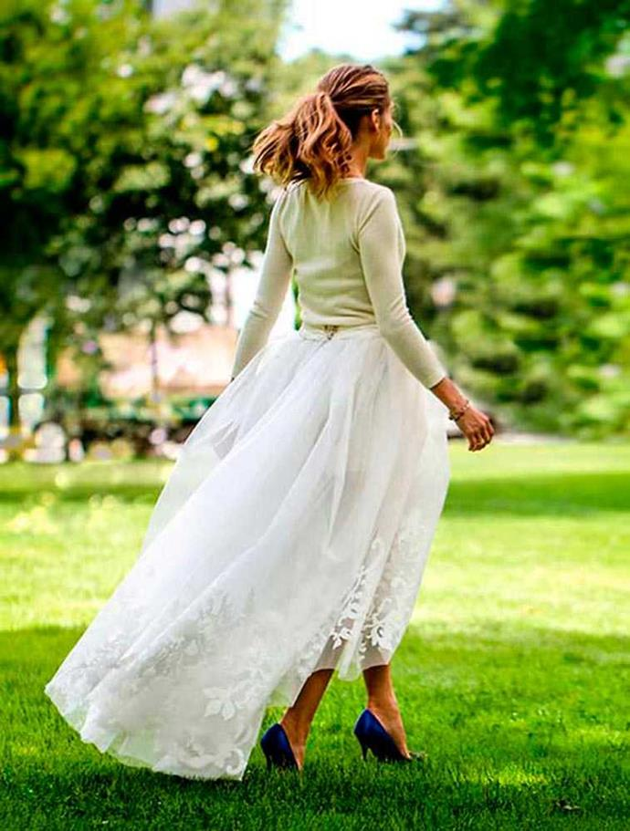 Olivia Palermo's Carolina Herrera wedding creation consisted of a cream cashmere jumper, white shorts and a full tulle skirt overlay. Oh, and not forgetting the blue shoes.