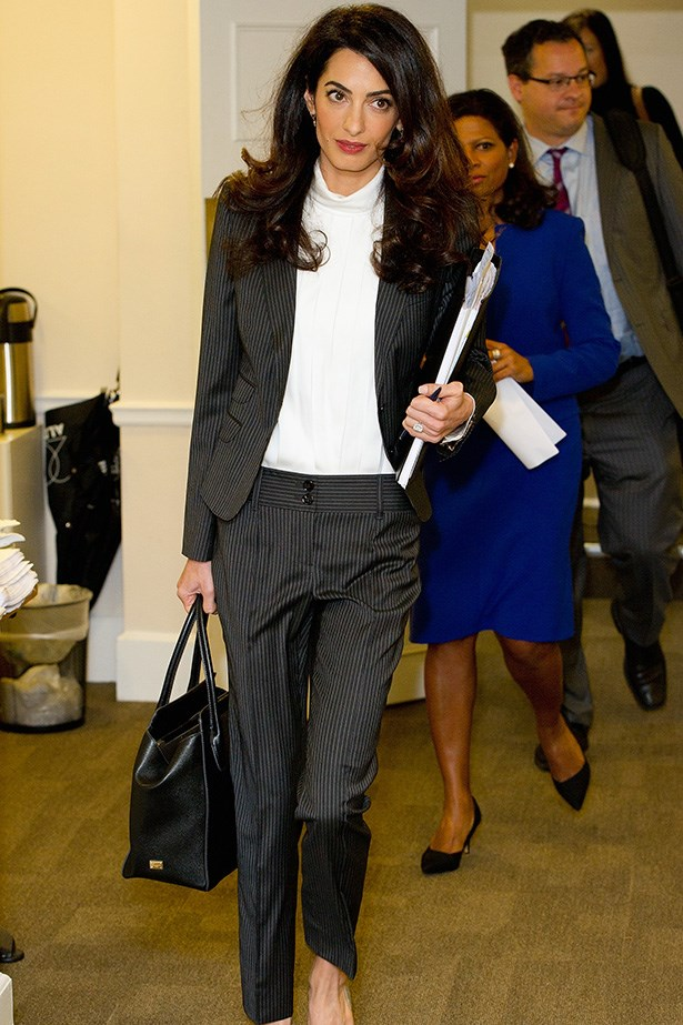 Now this is a (modern) power suit! Amal Clooney in full #ladyboss mode, wearing Dolce & Gabbana pinstripe trousers and Paul Andrew shoes.