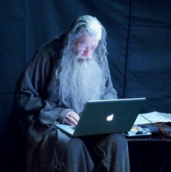 "<strong>The Lord Of The Rings</strong> <br> <br> Gandalf, played by Ian McKellen, using his laptop during a break. You shall not die! <br> <br> Image: <a href=""https://twitter.com/MakingOfs/status/646778339257008128/photo/1"">Twitter</a>"