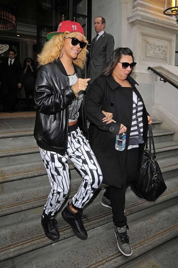 Rihanna in her Adidas sweat pants and hi-top sneakers.