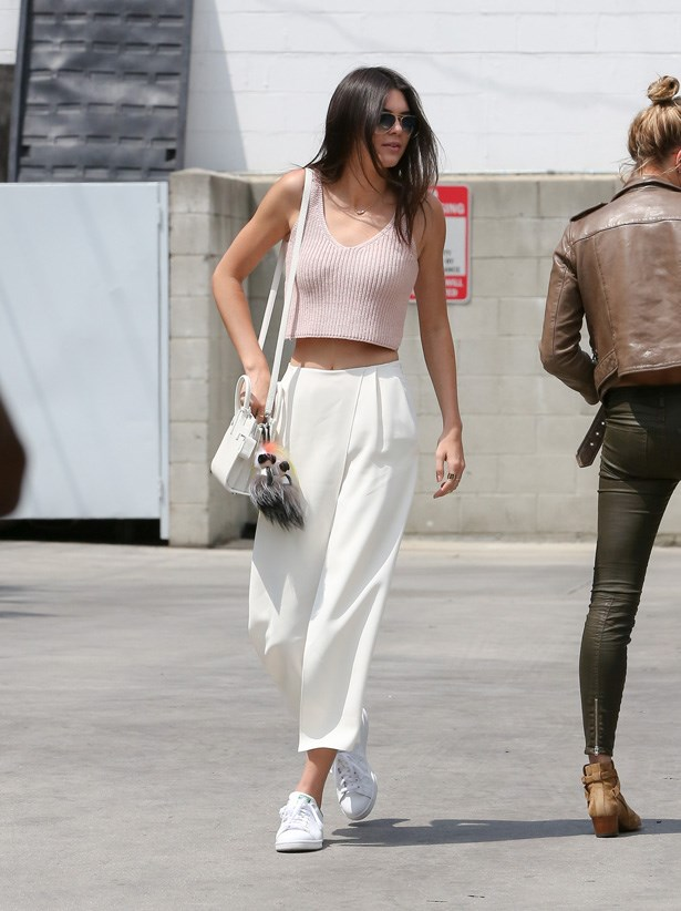 Kendall Jenner styles her trainers with this polished look.