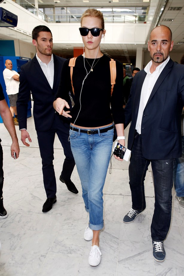 Karlie Kloss uses her Adidas trainers as her go-to travel shoes.