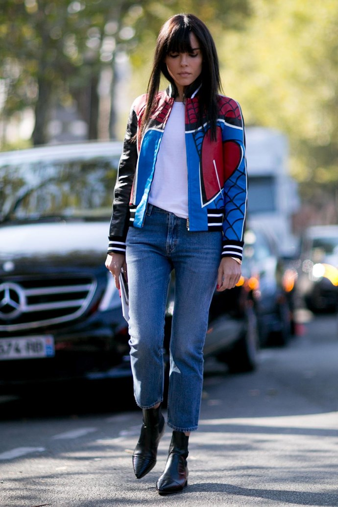 The classic white tee and jeans pairing gets a flashy update thanks to a statement moto jacket.