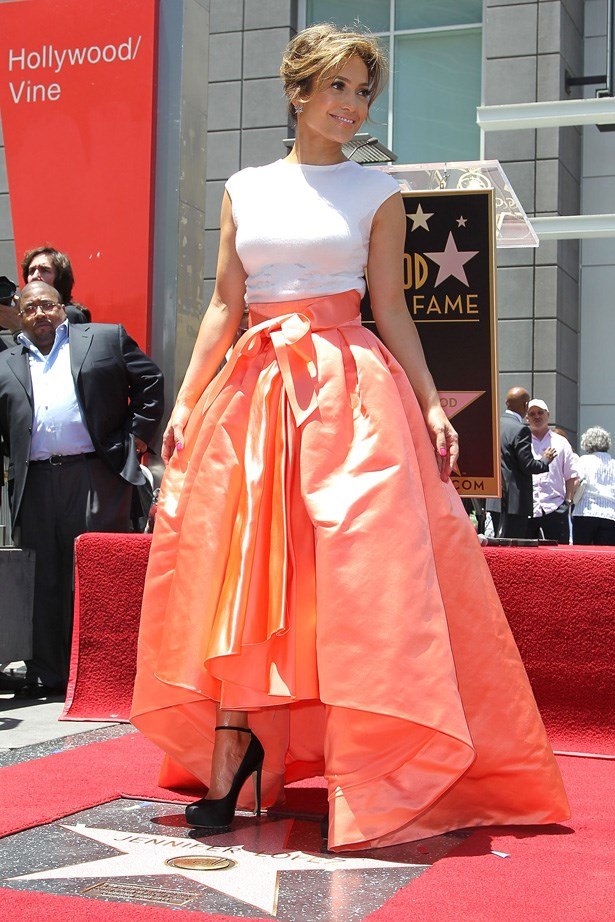 Jennifer Lopez turned heads in this orange Dior gown.