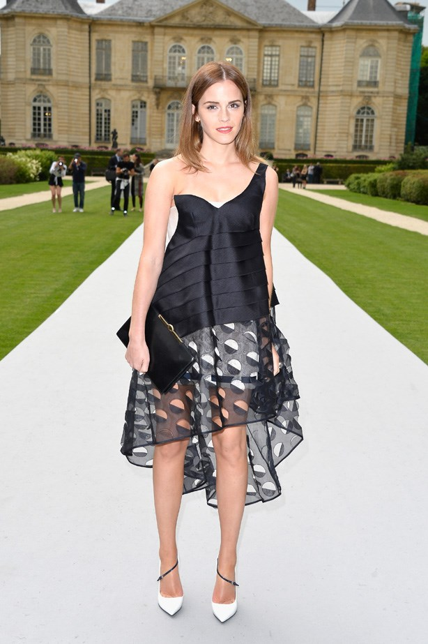 Emma Watson wows in this off-the-shoulder Dior gown. The back drop isn't bad either.