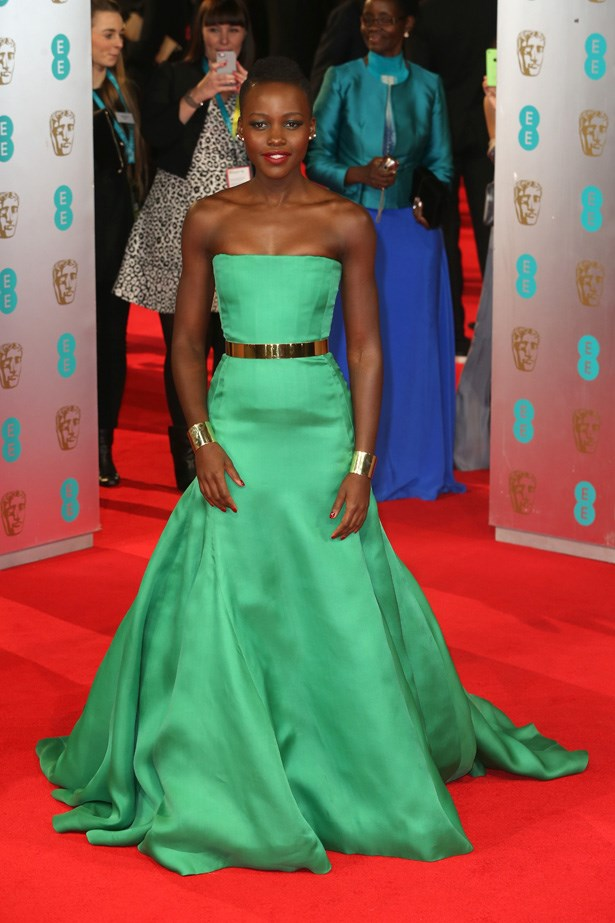 Lupita Nyong'o in a emerald green Dior gown.